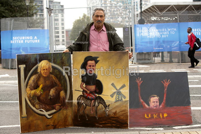 Artist Kaya Mar with satirical paintings of Boris Johnson IQ, David Cameron as Don Quixote tilting at EU windmills and David Cameron drowning in rivers of UKIP blood, outside Conservative Party Conference, The ICC Birmingham - John Harris - 2014-09-29