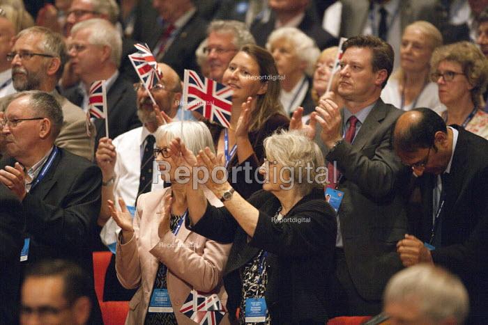 Delegates waving union Jack flags, David Cameron MP speaking, Conservative Party Conference, ICC Birmingham - John Harris - 2014-10-01