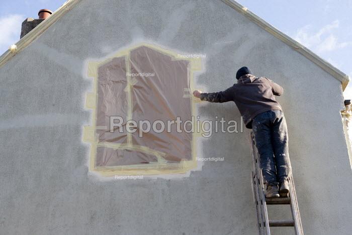 Builder redecorating the exterior of a house, Kineton, Warwickshire - John Harris - 2014-12-05