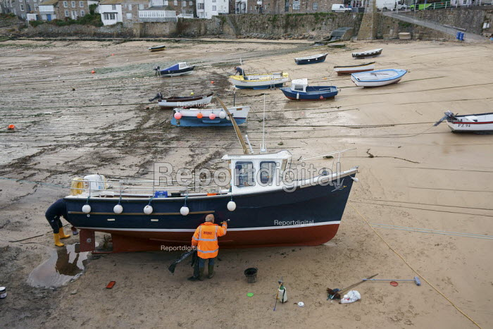 Painting and repairing a cruise boat, Mousehole harbour, Cornwall - John Harris - 2015-03-24