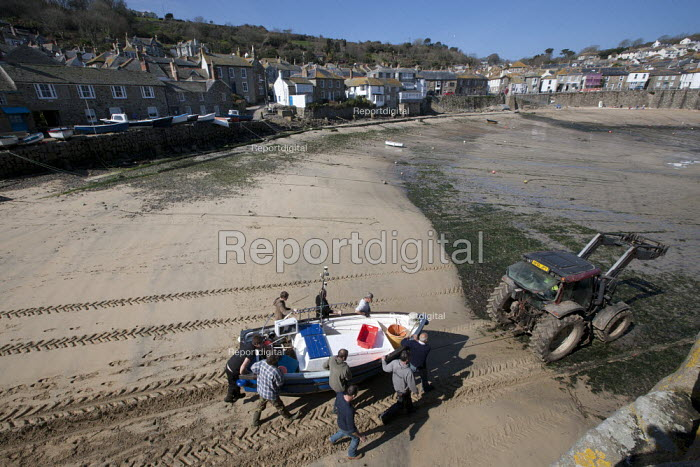 Tractor and fishermen launching the fishing fleet at the start of the season, Mousehole harbour, Cornwall - John Harris - 2015-03-21