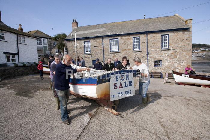 Launching the fishing fleet at the start of the season, Mousehole harbour, Cornwall - John Harris - 2015-03-21