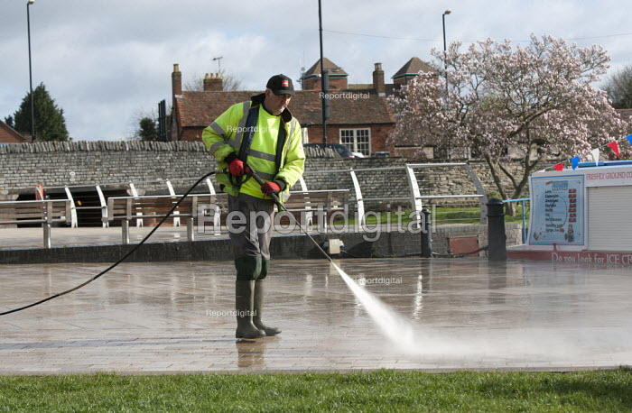 A Biffa street cleaner using a water jet to remove chewing gum from the pavement. Stratford upon Avon, Warwickshire - John Harris - 2015-04-01