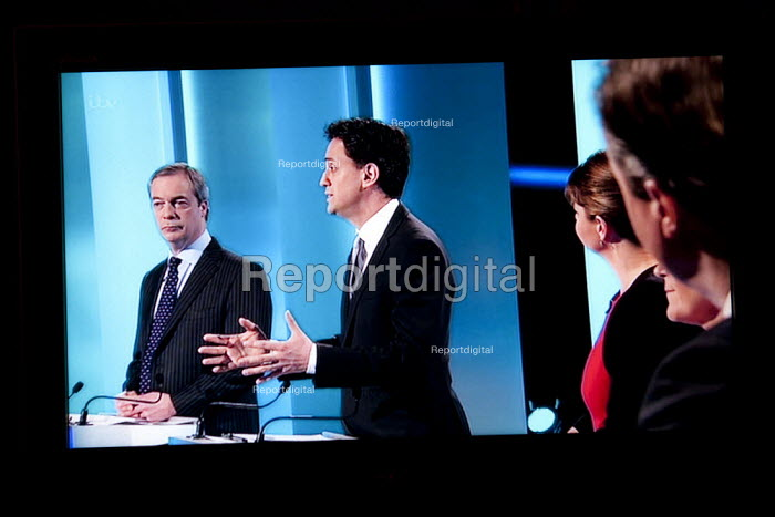 Nigel Farage UKIP, Ed Miliband, Labour Party. Stills from a TV showing The ITV Leaders' Debate watched by more than 7 million, UK General Election Campaign television program. - John Harris - 2015-04-02