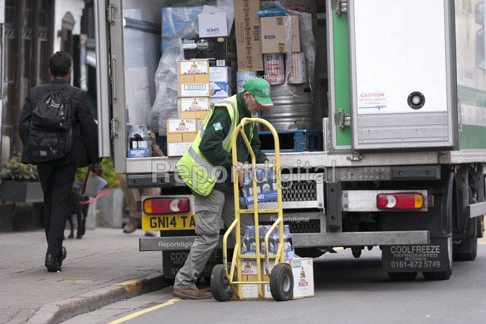 Driver unloading a delivery, Stratford upon Avon, Wawickshire - John Harris - 2013-04-29