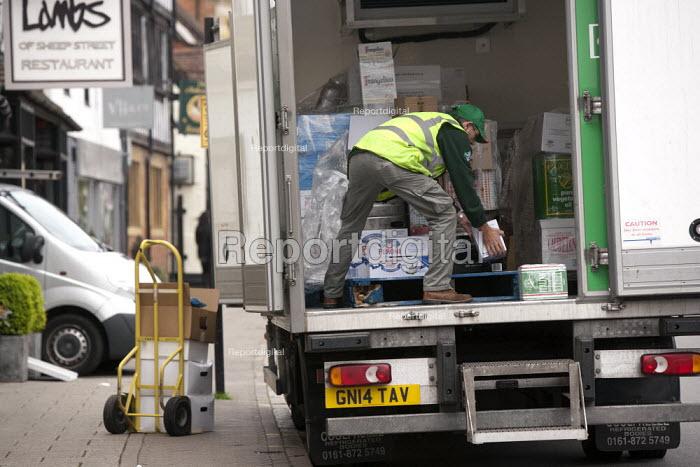 Driver unloading a delivery, Stratford upon Avon, Wawickshire - John Harris - 2015-05-06