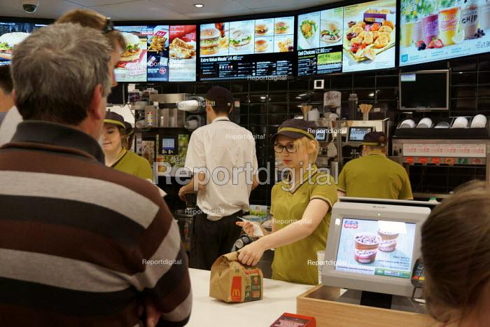 Workers serving customers, McDonald's restaurant, Stratford Upon Avon - John Harris - 2015-05-30