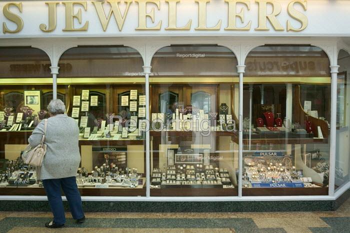 Woman looking into a Jewellers shop window, Stratford Upon Avon. - John Harris - 2015-05-30