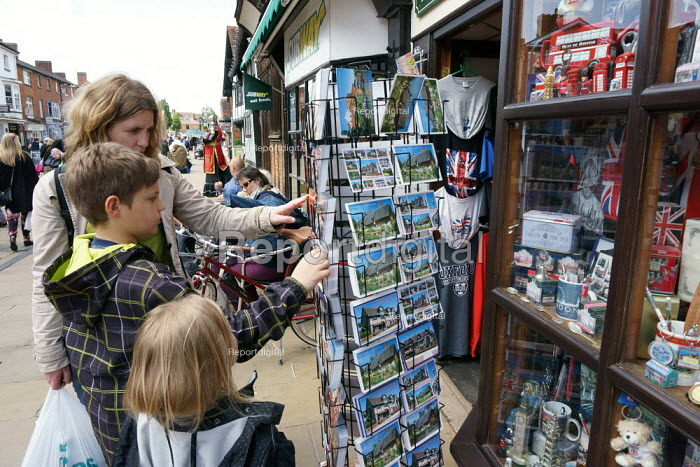 A family of tourists choosing a postcard, The Souvenir Shop, Stratford Upon Avon. - John Harris - 2015-05-30