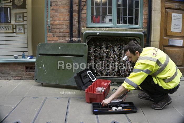 Contractor repairing a BT junction box, Stratford-Upon-Avon, Warwickshire - John Harris - 2015-06-05