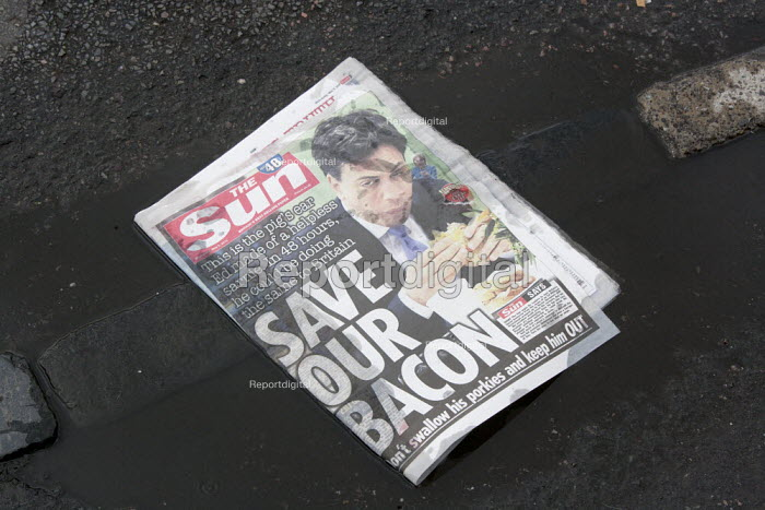 Front page of The Sun with a photograph showing Ed Miliband eating a bacon sandwich with the headline Save our Bacon, don't swallow his porkies and keep him out- suggesting the electorate should not vote for the Labour Party: This is the pig's ear Ed made of a helpless sarnie. In 24 hours he could be doing the same thing to Britain. - John Harris - 2015-05-07