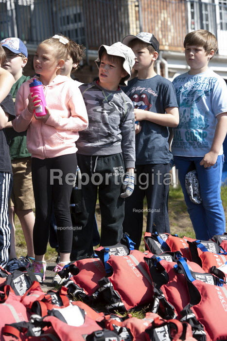 Putting on life jeckets. Pupils Bellboating on the river Avon, St Richard's First School, Evesham - John Harris - 2015-06-11