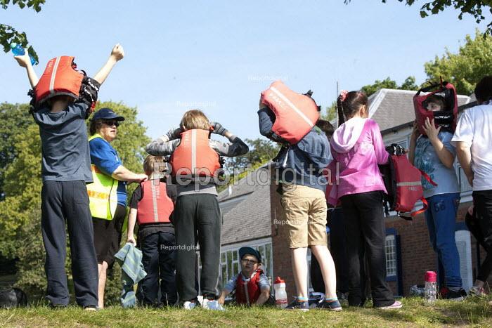 Putting on life jeckets. Pupils Bellboating on the river Avon, St Richard's First School, Evesham - John Harris - 2015-06-11