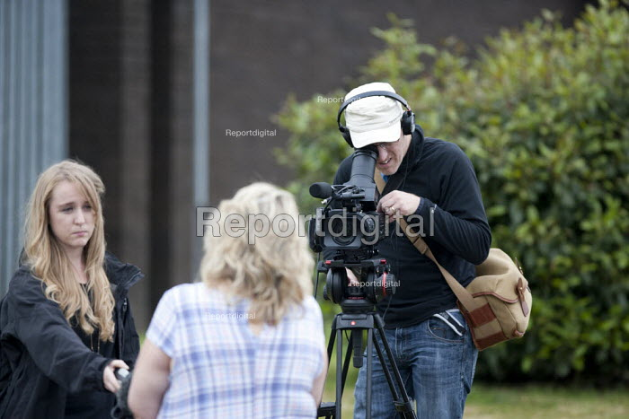 Journalist and camera oparator from CWU TV reporting on the Keep Wednesbury Working protest. CWU activists and members protest outside Dixons Carphone distribution centre, Wednesbury against 500 job losses - John Harris - 2015-06-12