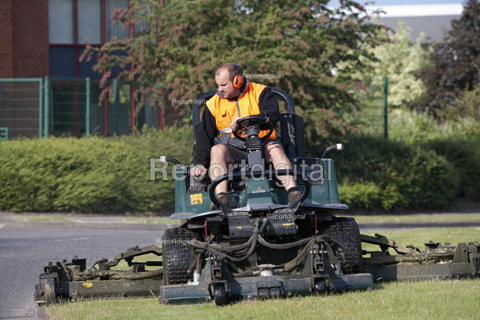 Subcontractor mowing the grass verge on a ride-on lawnmower, Evesham - John Harris - 2015-06-11