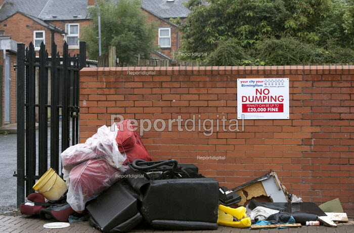 Rubbish dumped on the street by a City council NO DUMPING sign Birmingham - John Harris - 2015-07-26