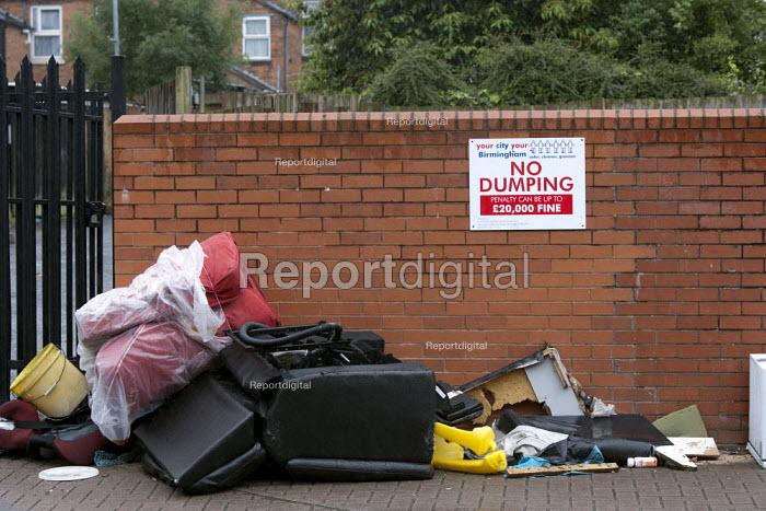 Rubbish dumped on the street by a City council NO DUMPING sign Birmingham - John Harris - 2015-07-26
