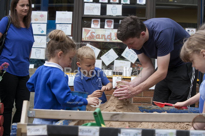 Playing in the sandbox. Open Day for parents of pupils at primary school, St Richards First School, Evesham, Worcestershire - John Harris - 2015-07-06