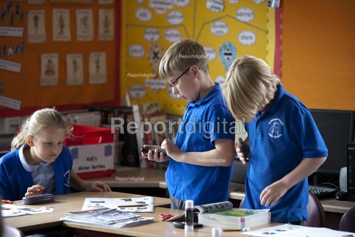 Mathematics lesson. Primary school, St Richards First School, Evesham, Worcestershire - John Harris - 2015-07-06