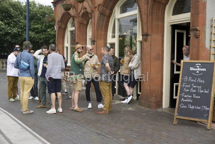 Men drinking outside the Woodman pub, Saturday lunchtime, Eastside, Birmingham - John Harris - 2015-06-27