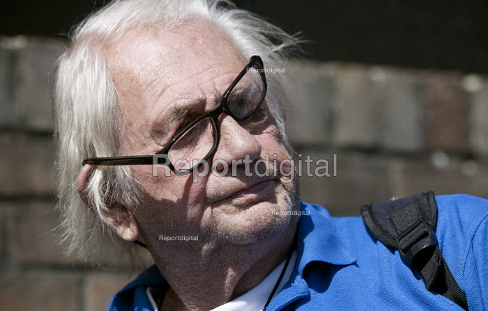 Man with a broken pair of glasses. - John Harris - 2015-07-19