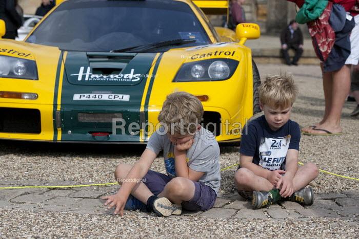 Salon Prive Supercar Show Blenheim Palace Oxfordshire Bored and grumpy boys infront of Harrods McLaren F1 GTR - John Harris - 2015-09-05
