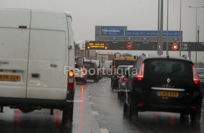 Traffic jam on M25 motorway in rain London - John Harris - 2015-09-15