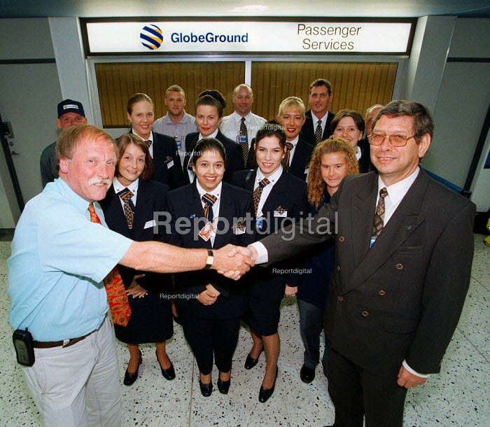 A new trade union recognition agreement has been signed between MSF and Globeground, handling agents for Lufthansa, Air Canada, Luxair, Aer Lingus and Cathay Pacific at Manchester and Birmingham Airport. Shown are some of the 225 staff who can now join the union after a majority vote, including passenger service, ramp handling, ticket sales and load control workers at Manchester Airport. On right is Managing Director of Globeground Hans Freise; left is Kevin Egan from MSF. - John Harris - 1999-06-17