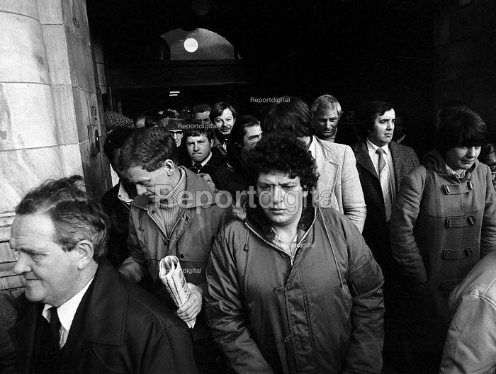 British Leyland BL car workers leaving a mass meeting having voted not to strike in support of trade union officials accused of leading a factory riot - John Harris - 1981-01-04