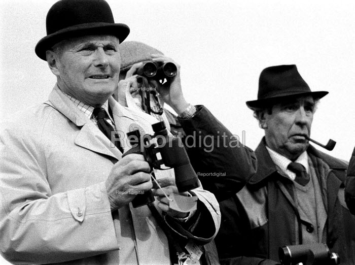 Watching a race meeting in the Cotswolds attended by landed gentry and wealthy. - John Harris - 1981-01-12