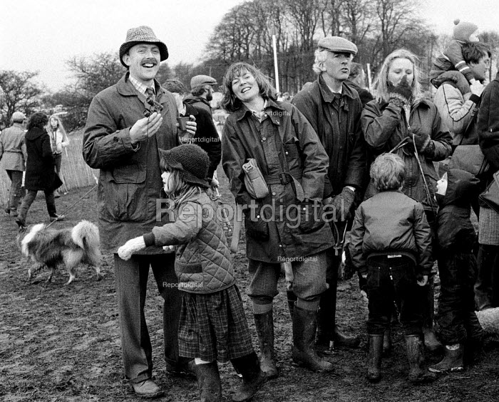Enjoying a drink at a Race meeting in the Cotswolds attended by landed gentry and wealthy. - John Harris - 1981-01-12