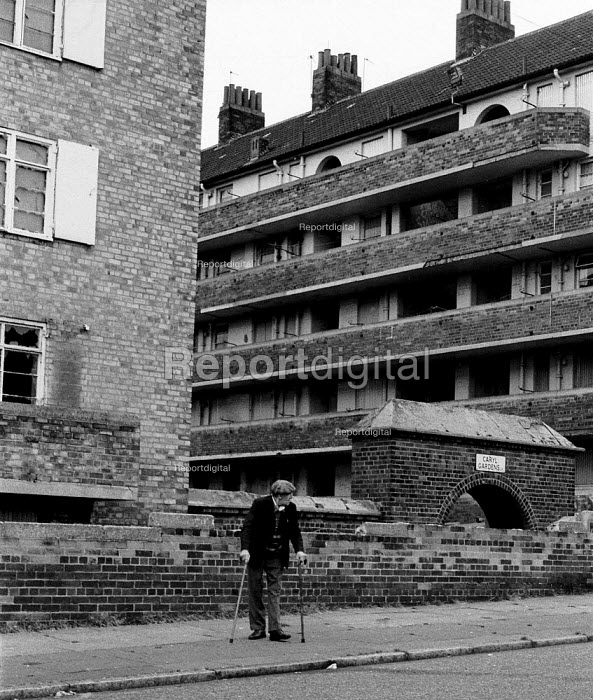 Disabled pensioner on crumbling housing estate Toxteth, Liverpool 1981, an area of high unemployment multiple deprivation poor health and high dependency on welfare - John Harris - 1981-07-26