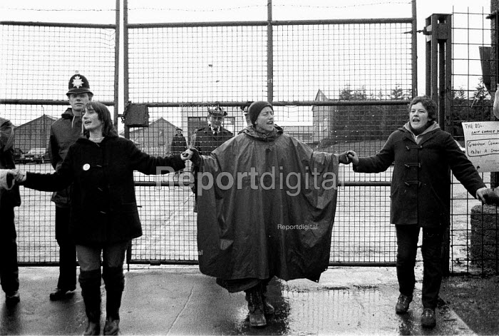 Embrace the base women protest at Greenham Common USAF American Airforce Base from which cruse missile launchers were deployed. 1982 - John Harris - 1982-12-12