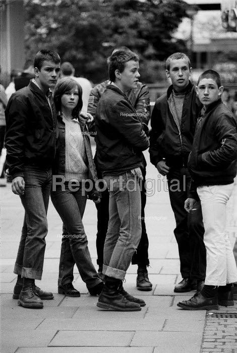 Unemployed youth with doc martin boots and union jack badges Coventry 1982 shopping precinct as recession in manufacturing intensifies - John Harris - 1982-03-30