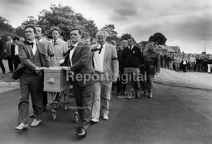 Striking miners walk with the coffin at the funeral of Joe Green, the second miner to have been killed on a picket line. Yorkshire coalfield 1984 - John Harris - 1984-06-22