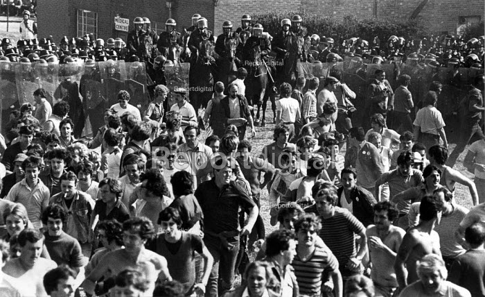 Police open their line of riot shields to allow mounted police in riot gear to charge into a mass picket of striking miners. Orgreave coke works Miners strike South Yorkshire - John Harris - 1984-06-11