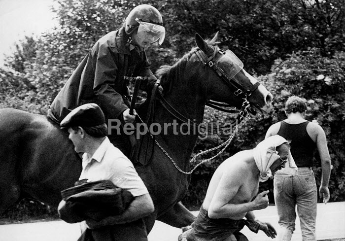 Mounted Police attack mass picket of striking miners. Orgreave coke works Miner's strike, Sheffield South Yorkshire - John Harris - 1984-06-18