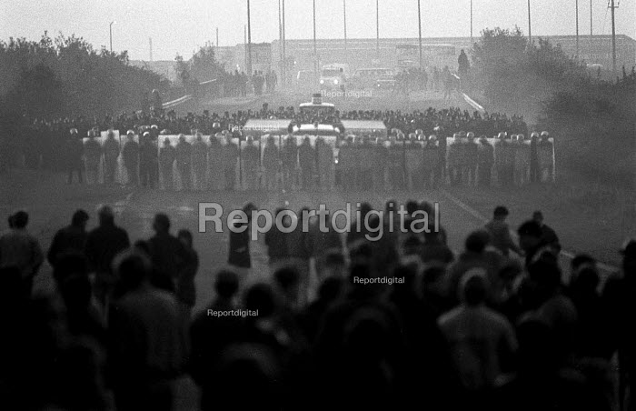 Police in riot gear charge a Mass picket of striking miners, Thurcroft pit South Yorkshire - John Harris - 1984-10-02