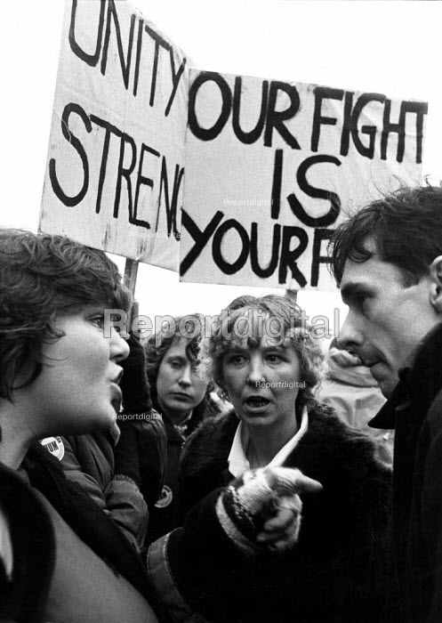 Coalville 1984 Miner's wives arguing the politics of the strike with a young Paul Mason, Workers Power member. The placards proclaim the slogans Unity is Strength and Our fight is your fight. Women against pit closures demonstration Leicestershire coalfield miner's strike 1984 - John Harris - 1984-03-24
