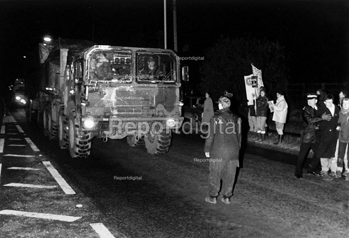 Cruisewatch protester halts a speeding USAF cruise missile launcher convoy returning to Greenham Common. Sailsbury Plane 1982 - John Harris - 1986-11-25