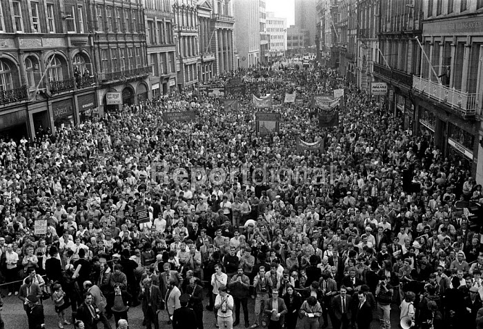 Thousands of trade union members protest in front of City Hall in support of the Liverpool Labour Council who exceeded Government limits on public expenditure, which was used by the Militant dominated local Authority to build houses, extend services, and preserve jobs - John Harris - 1984-03-07