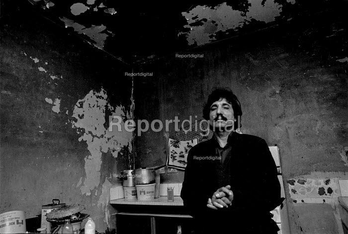 Asian man in damp housing Sparkhill Birmingham, a inner city area of low incomes and multiple deprivation, Birmingham - John Harris - 1987-03-26