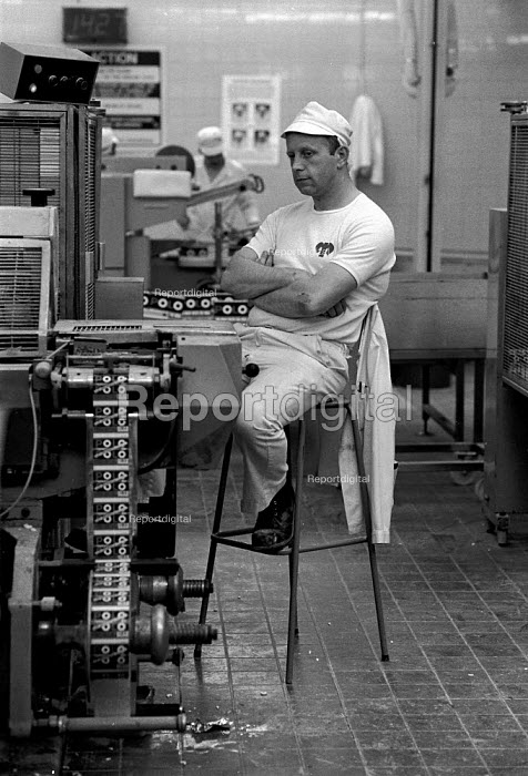 Worker watching the Polo mint production line Rowntree confectionery factory York - John Harris - 1988-05-27
