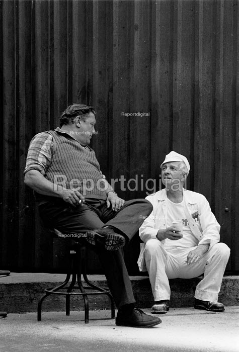 Workers talking and relaxing during a tea break outside Rowntree confectionery factory York - John Harris - 1988-05-27