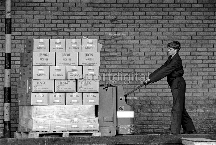 Youth loading boxes at the end of the production line. Ice cream factory Fiesta Foods Ltd West Midlands - John Harris - 1988-07-08