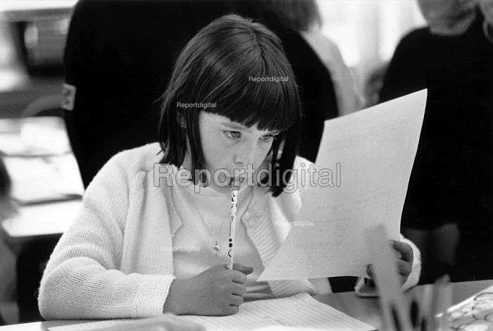 Pupil studying maths at a primary school - John Harris - 1988-07-14