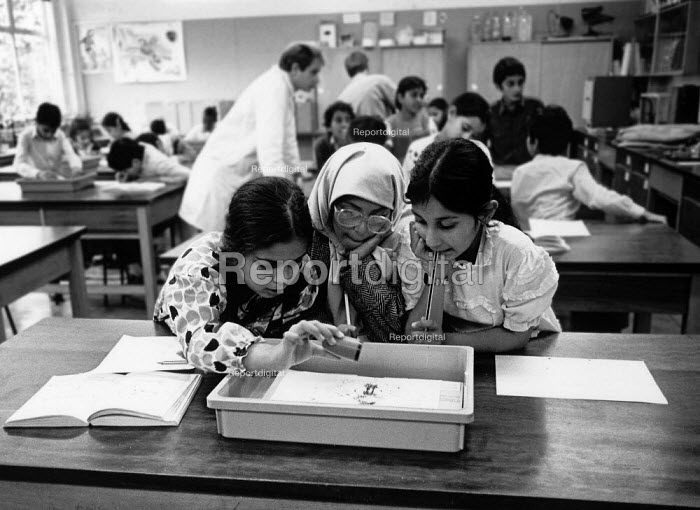 Asian girls working together on a science project School Mosley Birmingham - John Harris - 1988-10-29