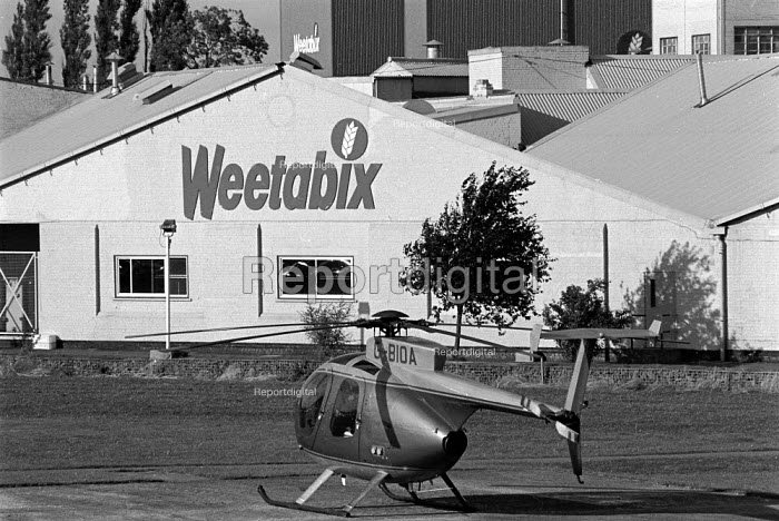 Managing Director's helicopter in which he commutes to work outside the Weetabix factory Kettering Many of the employees are women who work part time and are low paid - John Harris - 1988-09-29
