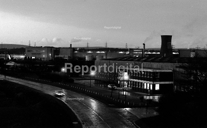 Car driving past Port Talbot steelworks in the rain. South Wales - John Harris - 1989-02-23