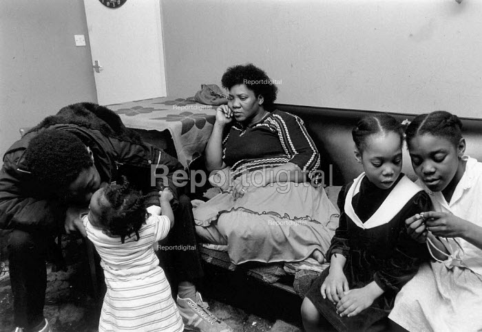 Mother with children in Handsworth Birmingham, an urban area with a high proportion of ethnic minorities and multiple deprivation : poverty and poor housing etc - John Harris - 1989-03-30